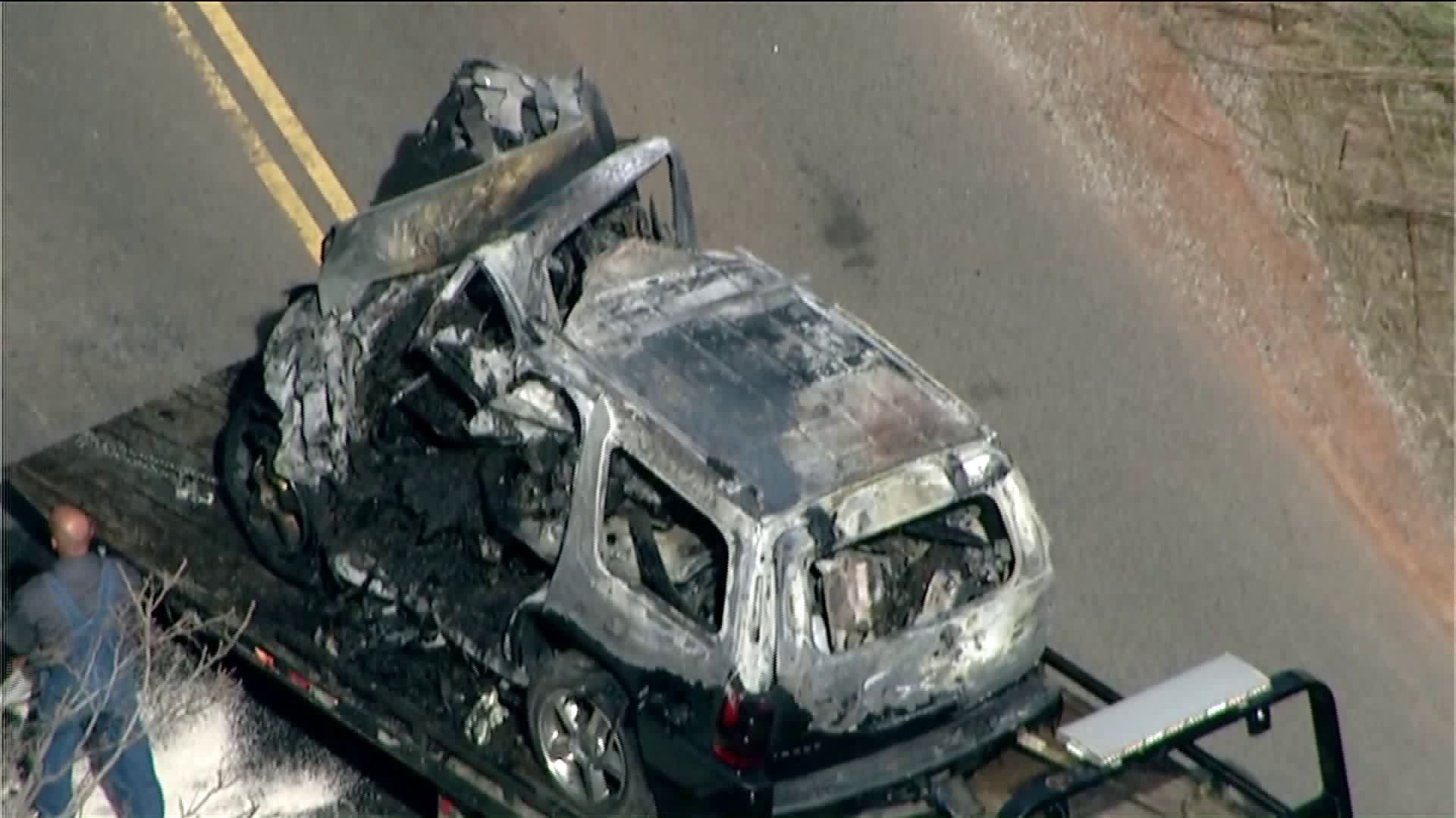 Aubrey McClendon's Chevy Tahoe caught fire after running into an overpass embankment.