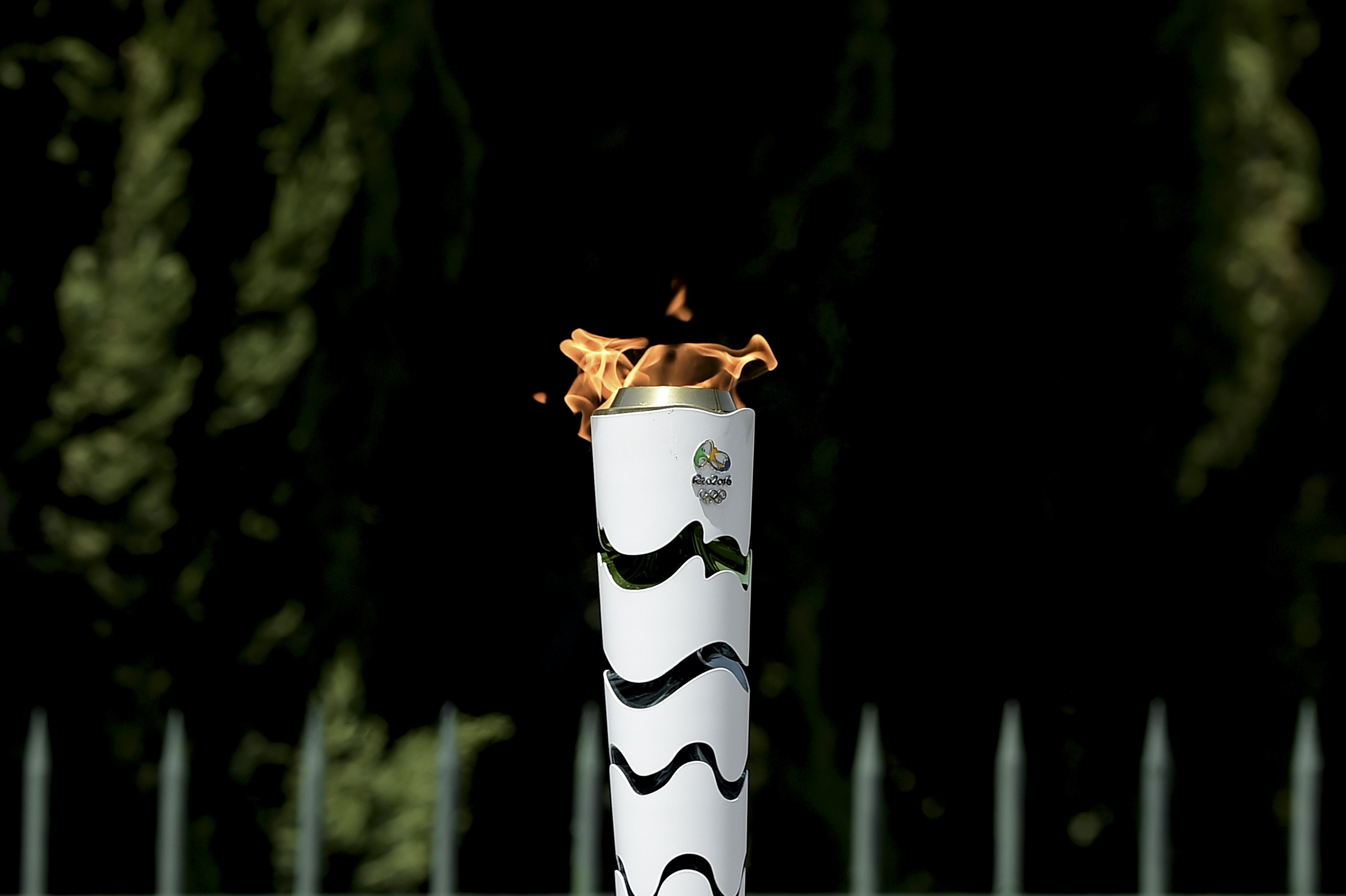 The Olympic Flame burns on a torch during the torch relay, on April 21, 2016, qfter the lighting ceremony of the Olympic flame in ancient Olympia, the sanctuary where the Olympic Games were born in 776 BC. The Olympic flame was lit Thursday in an ancient temple in one country in crisis and solemnly sent off carrying international hopes that Brazil's political paralysis will not taint the Rio Games that start in barely 100 days. / AFP / ARIS MESSINIS (Photo credit should read ARIS MESSINIS/AFP/Getty Images)