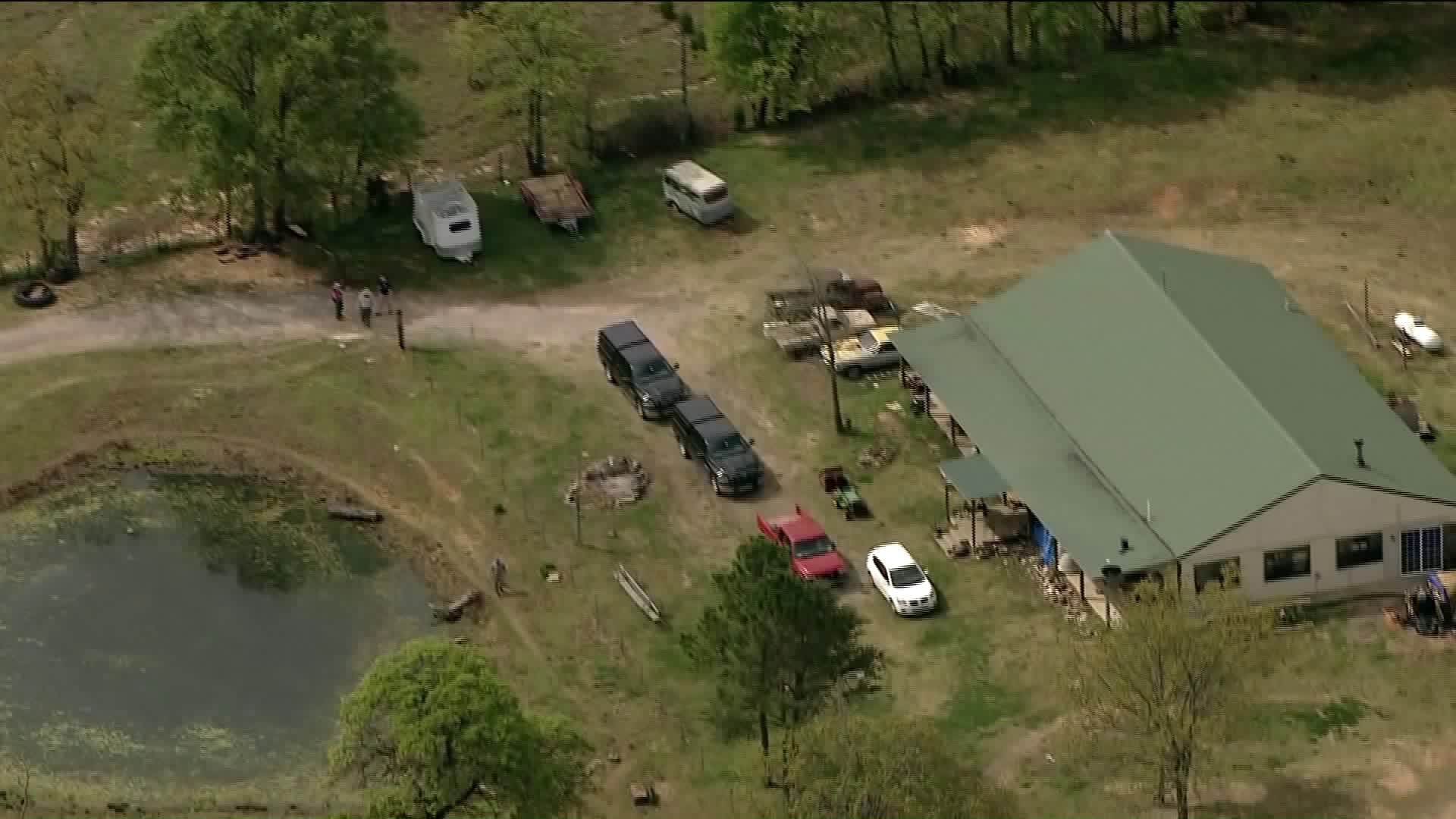 Officials searching a property in Seminole County