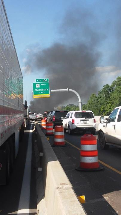 Traffic backed up due to multi-vehicle wreck in Norman that left multiple vehicles on fire.