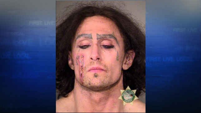 Police: Man arrested after damaging vehicles, licking man on the face