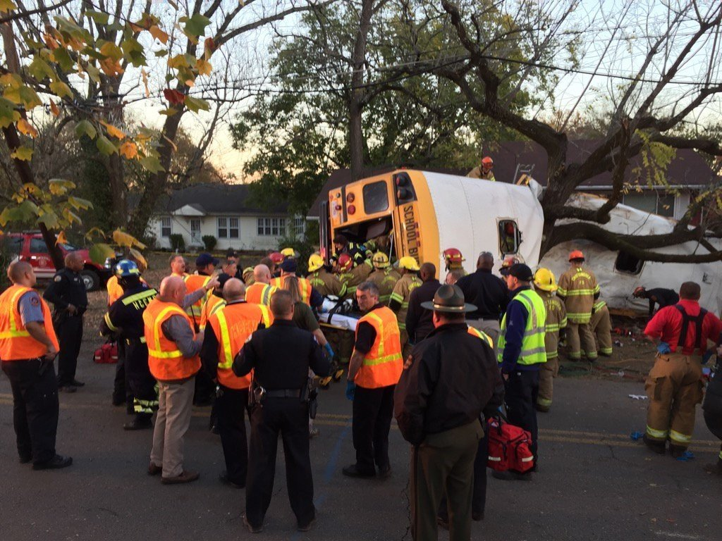 Medics rushed nearly two dozen people to hospitals in Chattanooga on Monday after a school bus crashed in the Tennessee city, officials said. The bus appears to have slammed into a tree and looks like it was split apart.