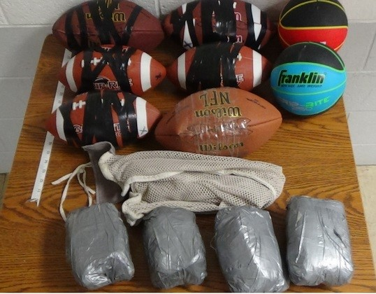 Contraband items sealed inside footballs and basketballs were thrown over the fence at Dick Conner Correctional Center.