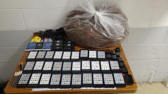 The contraband drop contianed 39 cellphones and nearly 10 pounds of tobacco