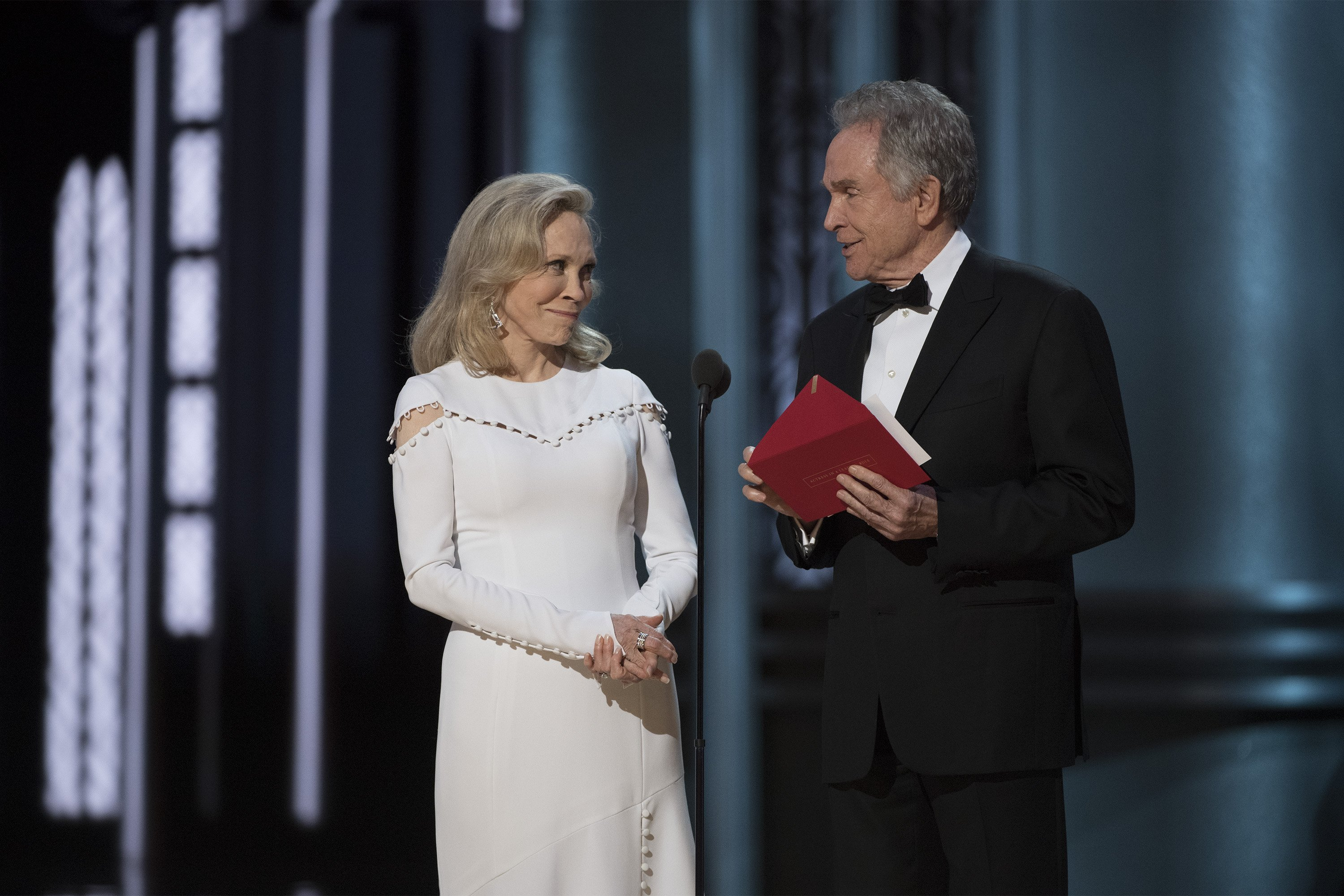 "Faye Dunaway, left, and Warren Beatty present the award for best picture, but the exterior on the envelope reads ""Actress in a Leading Role."" Credit:Eddy Chen/ABC"