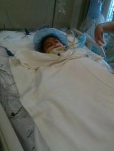 Desiree Macias in her hospital bed