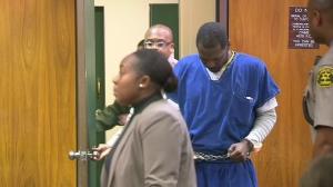 Christopher Warsaw appears in a blue jumpsuit in Inglewood Superior Court on Dec. 3, 2013. (Credit: KTLA)