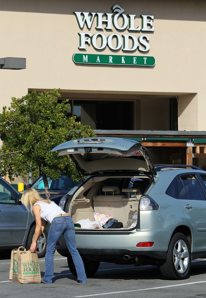 A customer loads bags of groceries into her car at a Whole Foods store February 17, 2010 in San Rafael, California. (Photo by Justin Sullivan/Getty Images)