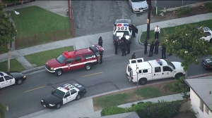 Police set up a perimeter in the neighborhoods near the mall to search for the gunman. (Credit: KTLA)