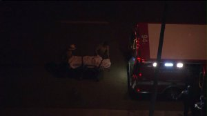 A body was removed from a garage during the search for a gunman who allegedly shot at a security guard outside the Baldwin Hills Crenshaw Plaza. (Credit: KTLA)