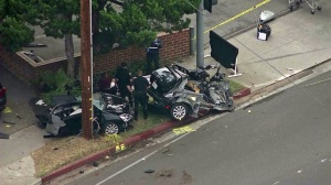 A car was cut in two following a crash in Pasadena on Monday, June 23, 2014. (Credit: KTLA)