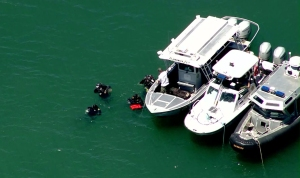 Divers searched for possible victims after a boat overturned at Pyramid Lake on Sunday, June 29, 2014. (Credit: KTLA)