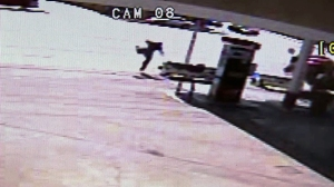 A still from surveillance video at a 76 gas station shows a Camaro collide with a bus stop. The person seen here just missed being hit in the fatal June 17, 2014, crash.