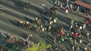 Mounted officers advanced down the street toward Huntington Park World Cup revelers on June 23, 2014. (Credit: KTLA)