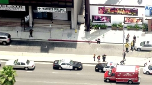 At least two crime scenes were visible - one at the Westin hotel and another near a pot shop. (Credit: KTLA)