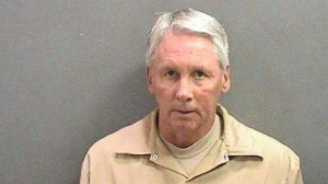 Alan Thomas Rigby is shown in a booking photo provided by the Orange County District Attorney's Office.