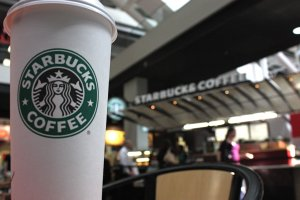 File photo of a Starbucks location and beverage. (Credit: Ferre' Dollar/CNN)