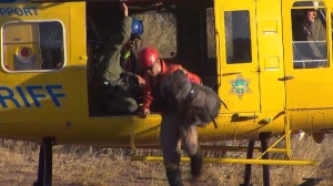 Search-and-rescue personnel searched for missing hiker Michael Herdman beginning Monday, June 16, 2014. Eight days later the only clues found were his footprints, backpack and two sightings of his dog. (Credit: KTLA)