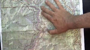 A search-and-rescue official points shows the area being searched for Mike Herdman on a topographic map on June 17, 2014. (Credit: KTLA)