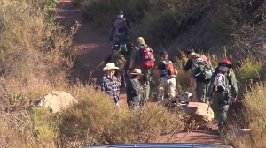 Searchers head up the trail to look for missing firefighter Mike Herdman in Los Padres National Forest on June 18, 2014. (Credit: KTLA)
