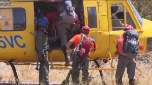 Searchers were ferried by helicopter to remote areas to search for Herdman on June 18, 2014. (Credit: KTLA)