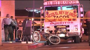 A shooting near a taco truck in East Los Angeles on June 29, 2014 left one person dead and another person injured. (Credit: KTLA)