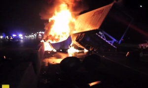 A big rig was engulfed in flames after slamming into the center divider on the 101 Freeway in Westlake Village on Sunday, June 29, 2014. (Credit: RMG News HD)