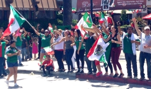 Fans celebrated the World Cup on Florence Avenue in Huntington Park on June 29, 2014, although Mexico lost to Netherlands 2-1. (Credit: KTLA)