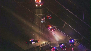Dozens of police and Highway Patrol officers were conducting a search of freeway. (Credit: KTLA)