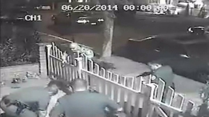 Surveillance video captured Santa Ana police officers beating a burglary suspect on June 20, 2014.