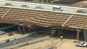 Aerial video showed the damage to the wooden overpass, which was under construction. (Credit: KTLA)