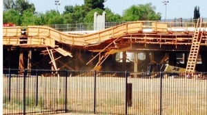 A bridge in a construction zone partially collapsed after being hit by a big rig on July 15, 2014. (Credit: Cal Fire Riverside)