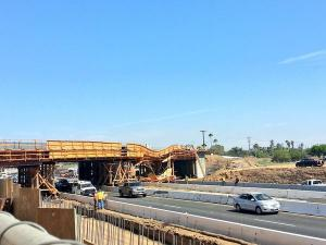 An overpass under construction collapsed, blocking the 215 Freeway in Perris on July 15, 2014. (Credit: @hippydriver)