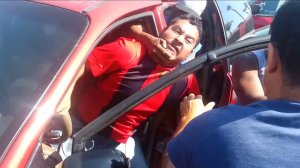 A group of bystanders helped stop an attempted carjacking in San Diego on July 13, 2014. (Credit: Aaron Leaf/ YouTube)