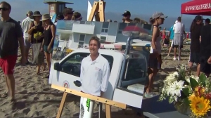 Thousands went to Newport Beach on July 13, 2014 to pay tribute to Ben Carlson, who drowned rescuing a swimmer one week earlier. (Credit: KTLA)