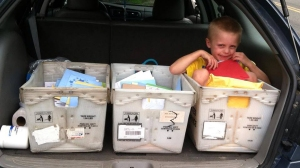 In a picture posted to Facebook, Danny Nickerson shows off three boxes filled with birthday cards addressed with him.