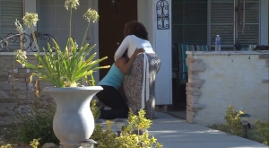 Family members gathered to mourn the death of Wilma Patterson, whose son said she was fatally shot July 22, 2014, in Moreno Valley. (Credit: KTLA)