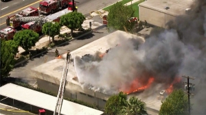 A massive fire caused a partial roof collapse at Animo South Los Angeles Charter High School on Tuesday, July 22, 2014. (Credit: KTLA)