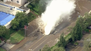 The water main break sent a geyser gushing into the air on July 29, 2014. (Credit: KTLA)