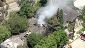 A home burned in Pacific Palisades on July 23, 2014. (Credit: KTLA)