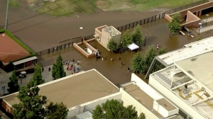 People could be seen wading through water from a massive main break on the UCLA campus July 29, 2014. (Credit: KTLA)