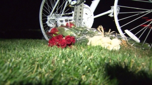 "A white ""ghost bike"" was placed at the scene were Olin died on Dec. 8, 2013. That bike and a replacement were stolen, Olin family attorneys said. (Credit: KTLA)"