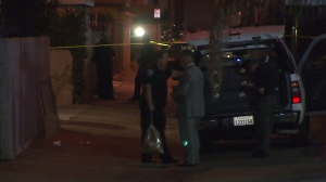 Investigators were combing for clues in an alley in Hawthorne after a man was shot and killed on July 16, 2014. (Credit: KTLA)