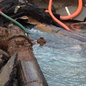 """The Los Angeles Department of Water and Power released a photo that shows the """"Y"""" juncture of two trunk lines, where a water main rupture occurred on Tuesday, July 29, 2014. (Credit: @LADWP/Twitter)"""