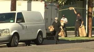 Investigators leave the scene where Xinran Ji was found dead on July 24, 2014. (Credit: KTLA)