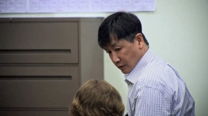 K.C. Joy looks at his attorney before being led from the courtroom July 29, 2014, after he was found guilty of second-degree murder in the death of Maribel Ramos. (Credit: KTLA)