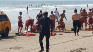 A swimmer was being treated on Venice Beach after being struck by lightning on July 27, 2014. (Credit: Peter Faust)