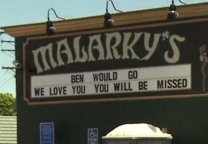 A sign honors lifeguard Ben Carlson at Malarky's pub in Newport Beach on July 7, 2014. (Credit: KTLA)