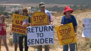 About 100 people protested the arrival of 140 undocumented immigrants in Murrieta on July 1, 2014. (Credit: KTLA)