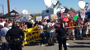 Dozens of supporters and protesters were out in Murrieta on July 4, 2014, as another group of 140 undocumented immigrants was expected to arrive at the U.S. Border Patrol Facility in the Riverside County city. (Credit: Steve Kuzj/KTLA)